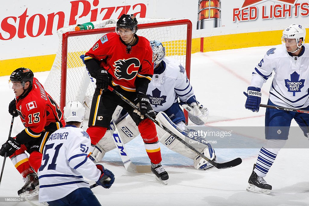 <a gi-track='captionPersonalityLinkClicked' href=/galleries/search?phrase=Joe+Colborne&family=editorial&specificpeople=5370968 ng-click='$event.stopPropagation()'>Joe Colborne</a> #8 and Michael Cammalleri #13 of the Calgary Flames skate against <a gi-track='captionPersonalityLinkClicked' href=/galleries/search?phrase=Jake+Gardiner&family=editorial&specificpeople=4884939 ng-click='$event.stopPropagation()'>Jake Gardiner</a> #51 and <a gi-track='captionPersonalityLinkClicked' href=/galleries/search?phrase=Paul+Ranger&family=editorial&specificpeople=544991 ng-click='$event.stopPropagation()'>Paul Ranger</a> #15 of the Toronto Maple Leafs at Scotiabank Saddledome on October 30, 2013 in Calgary, Alberta, Canada.