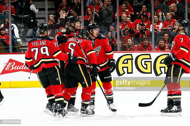 Joe Colborne Mikael Backlund and teammates of the Calgary Flames celebrate a goal against the Winnipeg Jets during an NHL game at Scotiabank...
