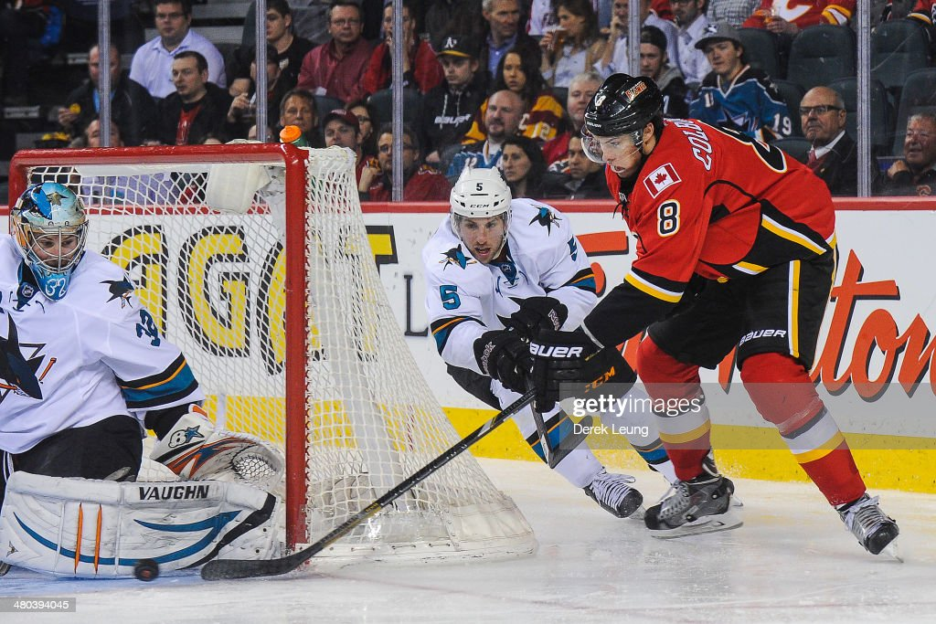 Joe Colborne #8 of the Calgary Flames attempts a wrap-around on Alex Stalock #32 of the San Jose Sharks during an NHL game at Scotiabank Saddledome on March 24, 2014 in Calgary, Alberta, Canada. The Flames defeated the Sharks 2-1 in shootout.