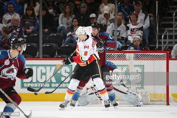 Joe Colborne of the Calgary Flames attempts to deflect the puck past Erik Johnson and Goaltender Semyon Varlamov of the Colorado Avalanche at the...