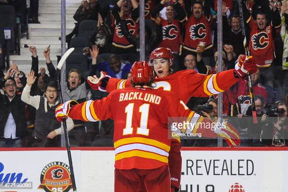 Joe Colborne of the Calgary Flames celebrates after scoring the game winning goal against the New York Islanders during an NHL game at Scotiabank...