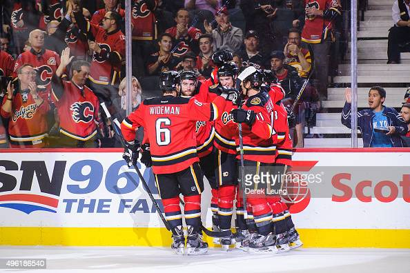 Joe Colborne of the Calgary Flames celebrates with his teammates after scoring against the Pittsburgh Penguins during an NHL game at Scotiabank...