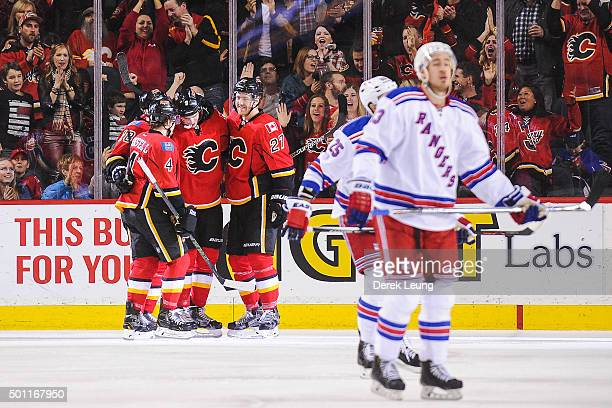 Joe Colborne of the Calgary Flames celebrates with his teammates after scoring against the New York Rangers during an NHL game at Scotiabank...