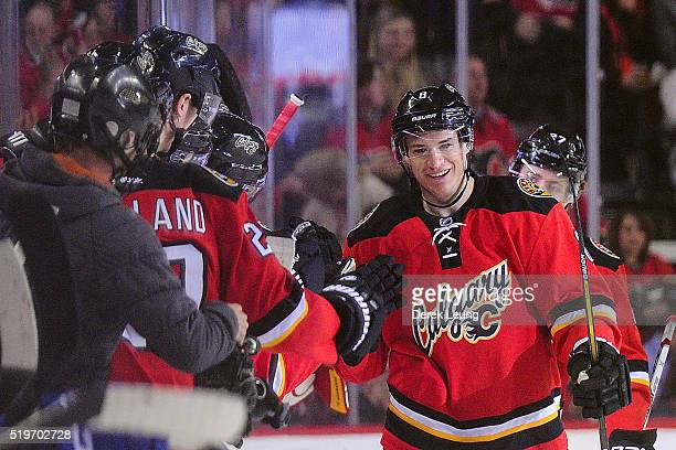 Joe Colborne of the Calgary Flames celebrates with his teammates after scoring against the Vancouver Canucks during an NHL game at Scotiabank...
