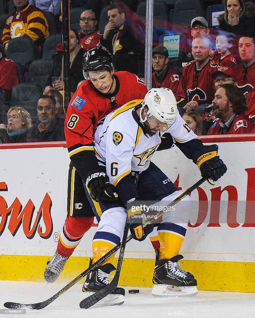 <a gi-track='captionPersonalityLinkClicked' href=/galleries/search?phrase=Joe+Colborne&family=editorial&specificpeople=5370968 ng-click='$event.stopPropagation()'>Joe Colborne</a> #8 of the Calgary Flames checks <a gi-track='captionPersonalityLinkClicked' href=/galleries/search?phrase=Shea+Weber&family=editorial&specificpeople=554412 ng-click='$event.stopPropagation()'>Shea Weber</a> #6 of the Nashville Predators during an NHL game at Scotiabank Saddledome on March 21, 2014 in Calgary, Alberta, Canada. The Predators defeated the Flames 6-5.