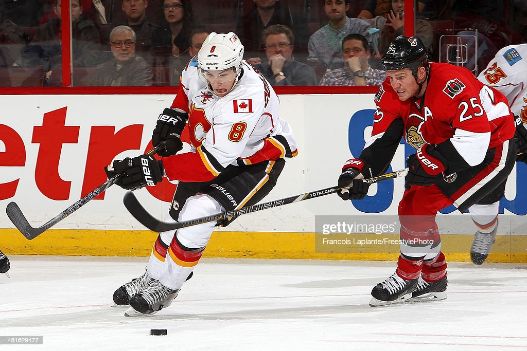 <a gi-track='captionPersonalityLinkClicked' href=/galleries/search?phrase=Joe+Colborne&family=editorial&specificpeople=5370968 ng-click='$event.stopPropagation()'>Joe Colborne</a> #8 of the Calgary Flames controls the puck against Chris Neil #25 of the Ottawa Senators during an NHL game at Canadian Tire Centre on March 30, 2014 in Ottawa, Ontario, Canada.