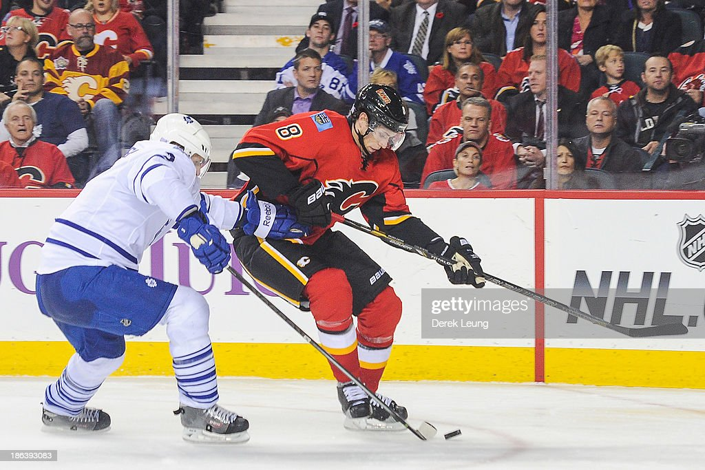 <a gi-track='captionPersonalityLinkClicked' href=/galleries/search?phrase=Joe+Colborne&family=editorial&specificpeople=5370968 ng-click='$event.stopPropagation()'>Joe Colborne</a> #8 of the Calgary Flames fights for the puck against <a gi-track='captionPersonalityLinkClicked' href=/galleries/search?phrase=Dion+Phaneuf&family=editorial&specificpeople=545455 ng-click='$event.stopPropagation()'>Dion Phaneuf</a> #3 of the Toronto Maple Leafs during an NHL game at Scotiabank Saddledome on October 30, 2013 in Calgary, Alberta, Canada.