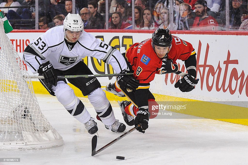 Joe Colborne #8 of the Calgary Flames flies in the air while chasing the puck against Kevin Gravel #53 of the Los Angeles Kings during an NHL game at Scotiabank Saddledome on April 5, 2016 in Calgary, Alberta, Canada.