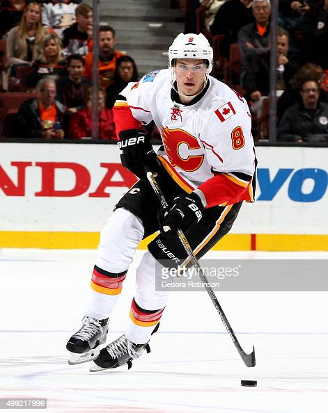 Joe Colborne of the Calgary Flames handles the puck during the game against the Anaheim Ducks on November 24 2015 at Honda Center in Anaheim...