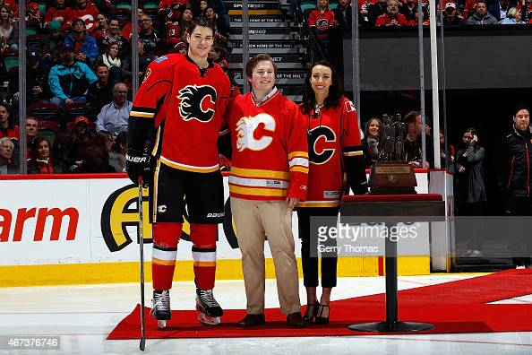 Joe Colborne of the Calgary Flames is presented with the Ralph T Scurfield Humanitarian Award before the game against the Colorado Avalanche at...