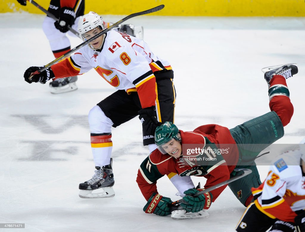 <a gi-track='captionPersonalityLinkClicked' href=/galleries/search?phrase=Joe+Colborne&family=editorial&specificpeople=5370968 ng-click='$event.stopPropagation()'>Joe Colborne</a> #8 of the Calgary Flames looks on as <a gi-track='captionPersonalityLinkClicked' href=/galleries/search?phrase=Zach+Parise&family=editorial&specificpeople=213606 ng-click='$event.stopPropagation()'>Zach Parise</a> #11 of the Minnesota Wild falls to the ice during the third period of the game on March 3, 2014 at Xcel Energy Center in St Paul, Minnesota. The Wild defeated the Flames 3-2.