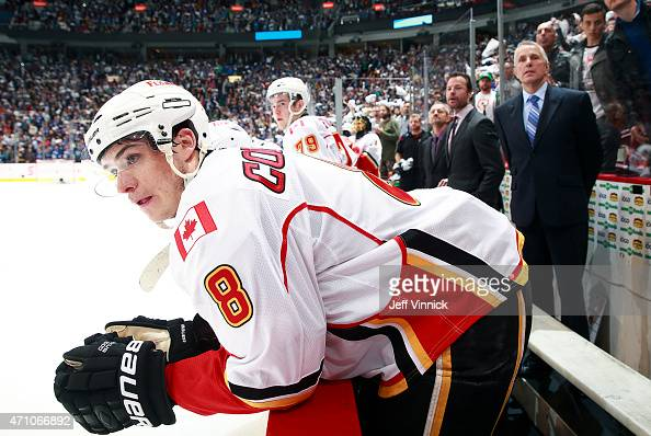 Joe Colborne of the Calgary Flames looks on from the bench during Game Five of the Western Conference Quarterfinals against the Vancouver Canucks...