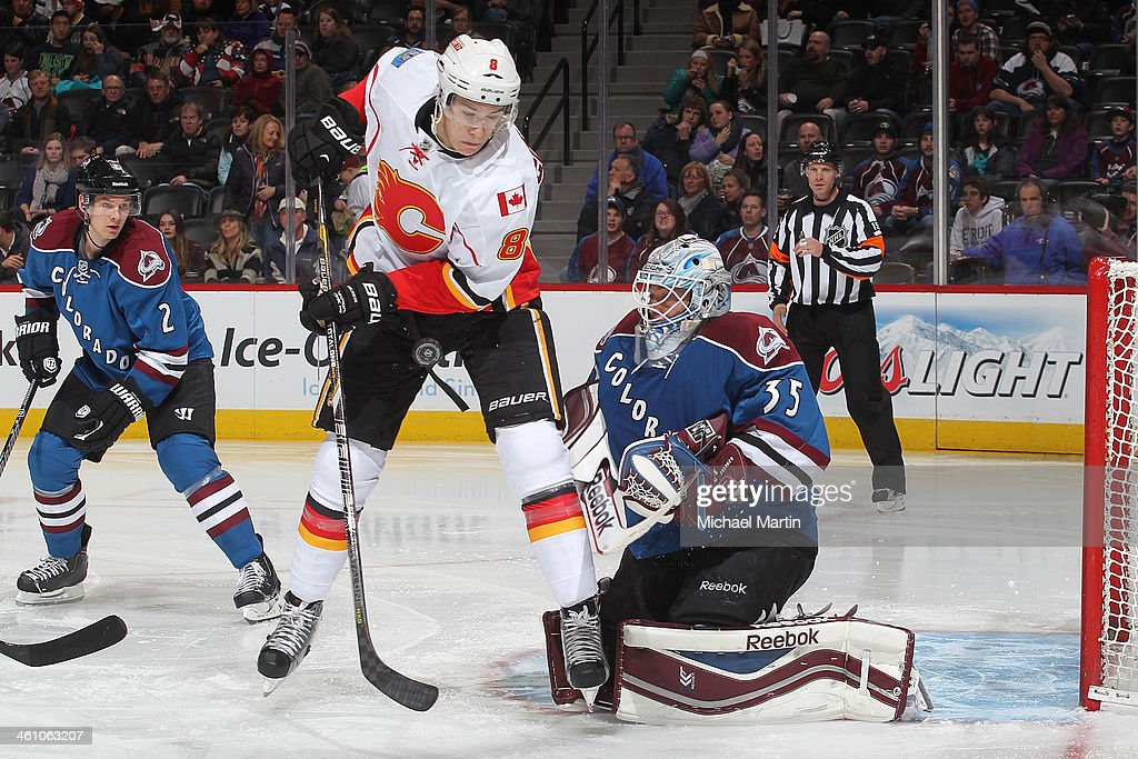 <a gi-track='captionPersonalityLinkClicked' href=/galleries/search?phrase=Joe+Colborne&family=editorial&specificpeople=5370968 ng-click='$event.stopPropagation()'>Joe Colborne</a> #8 of the Calgary Flames plays the puck as goaltender Jean Sebastien Giguere #35 and <a gi-track='captionPersonalityLinkClicked' href=/galleries/search?phrase=Nick+Holden&family=editorial&specificpeople=5635993 ng-click='$event.stopPropagation()'>Nick Holden</a> #2 of the Colorado Avalanche defend at the Pepsi Center on January 06, 2014 in Denver, Colorado.