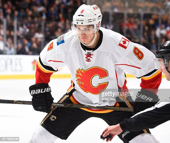 Joe Colborne of the Calgary Flames prepares for a faceoff against the Toronto Maple Leafs during game action on March 21 2016 at Air Canada Centre in...