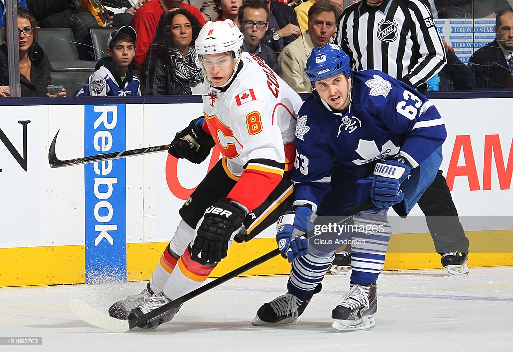 Joe Colborne #8 of the Calgary Flames skates against David Bolland #63 of the Toronto Maple Leafs during an NHL game at the Air Canada Centre on April 1, 2014 in Toronto, Ontario, Canada.