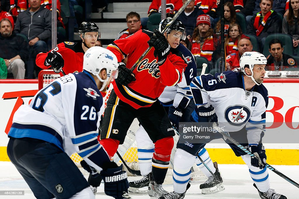 <a gi-track='captionPersonalityLinkClicked' href=/galleries/search?phrase=Joe+Colborne&family=editorial&specificpeople=5370968 ng-click='$event.stopPropagation()'>Joe Colborne</a> #8 of the Calgary Flames skates against Mark Stuart #5 of the Winnipeg Jets at Scotiabank Saddledome on April 11, 2014 in Calgary, Alberta, Canada.