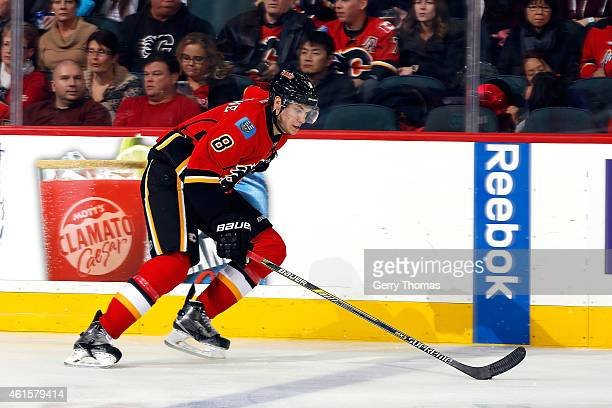 Joe Colborne of the Calgary Flames skates against the Edmonton Oilers at Scotiabank Saddledome on December 31 2014 in Calgary Alberta Canada The...