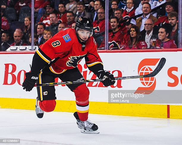 Joe Colborne of the Calgary Flames skates against the San Jose Sharks during an NHL game at Scotiabank Saddledome on November 12 2013 in Calgary...