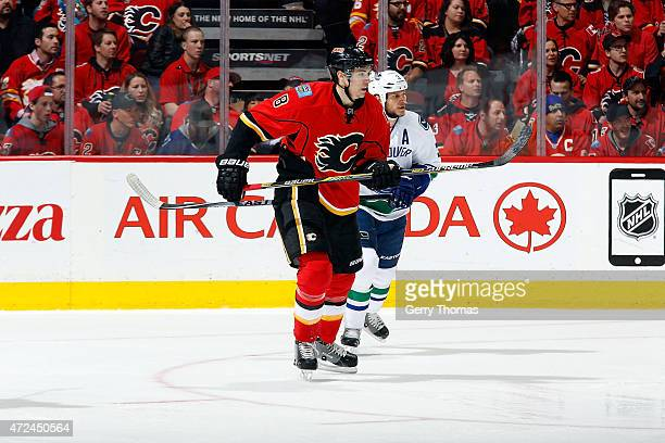 Joe Colborne of the Calgary Flames skates against the Vancouver Canucks at Scotiabank Saddledome for Game Six of the Western Quarterfinals during the...