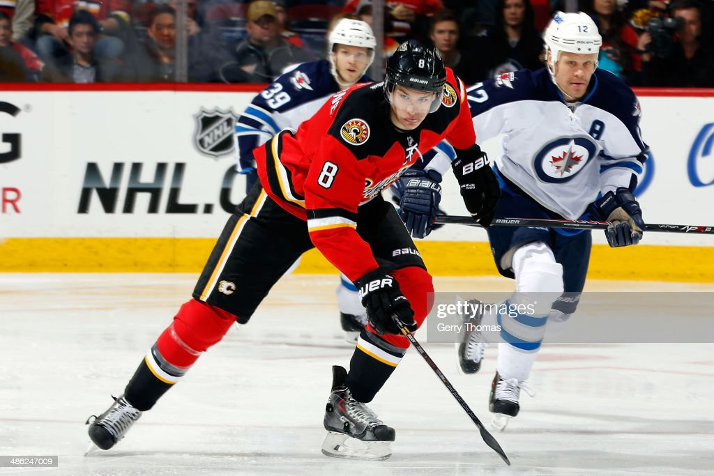 Joe Colborne #8 of the Calgary Flames skates against the Winnipeg Jets at Scotiabank Saddledome on April 11, 2014 in Calgary, Alberta, Canada. The Jets won 4-3.