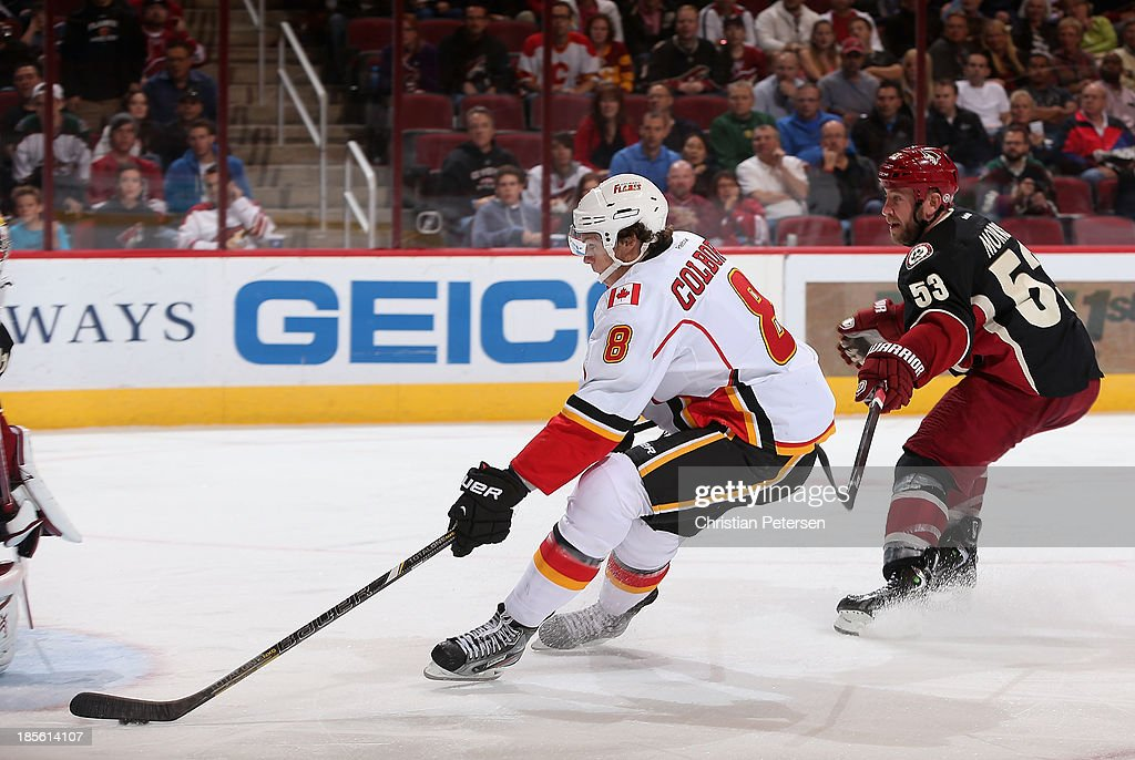 <a gi-track='captionPersonalityLinkClicked' href=/galleries/search?phrase=Joe+Colborne&family=editorial&specificpeople=5370968 ng-click='$event.stopPropagation()'>Joe Colborne</a> #8 of the Calgary Flames skates in to score a third period goal past <a gi-track='captionPersonalityLinkClicked' href=/galleries/search?phrase=Derek+Morris&family=editorial&specificpeople=204188 ng-click='$event.stopPropagation()'>Derek Morris</a> #53 of the Phoenix Coyotes during the NHL game at Jobing.com Arena on October 22, 2013 in Glendale, Arizona. The Coyotes defeated the Flames 4-2.