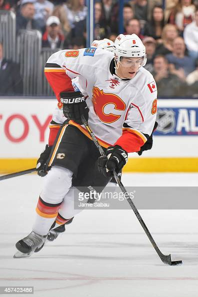 Joe Colborne of the Calgary Flames skates with the puck against the Columbus Blue Jackets on October 17 2014 at Nationwide Arena in Columbus Ohio