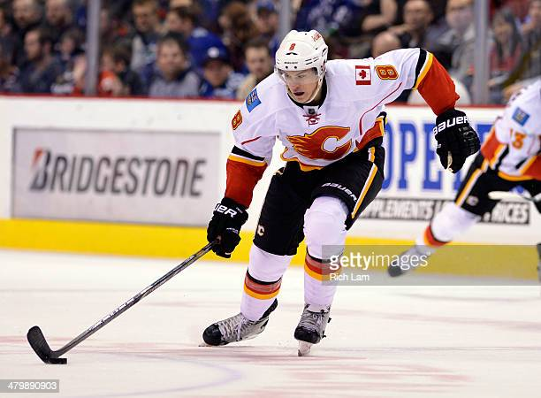 Joe Colborne of the Calgary Flames skates with the puck during NHL action against the Vancouver Canucks on March 08 2014 at Rogers Arena in Vancouver...