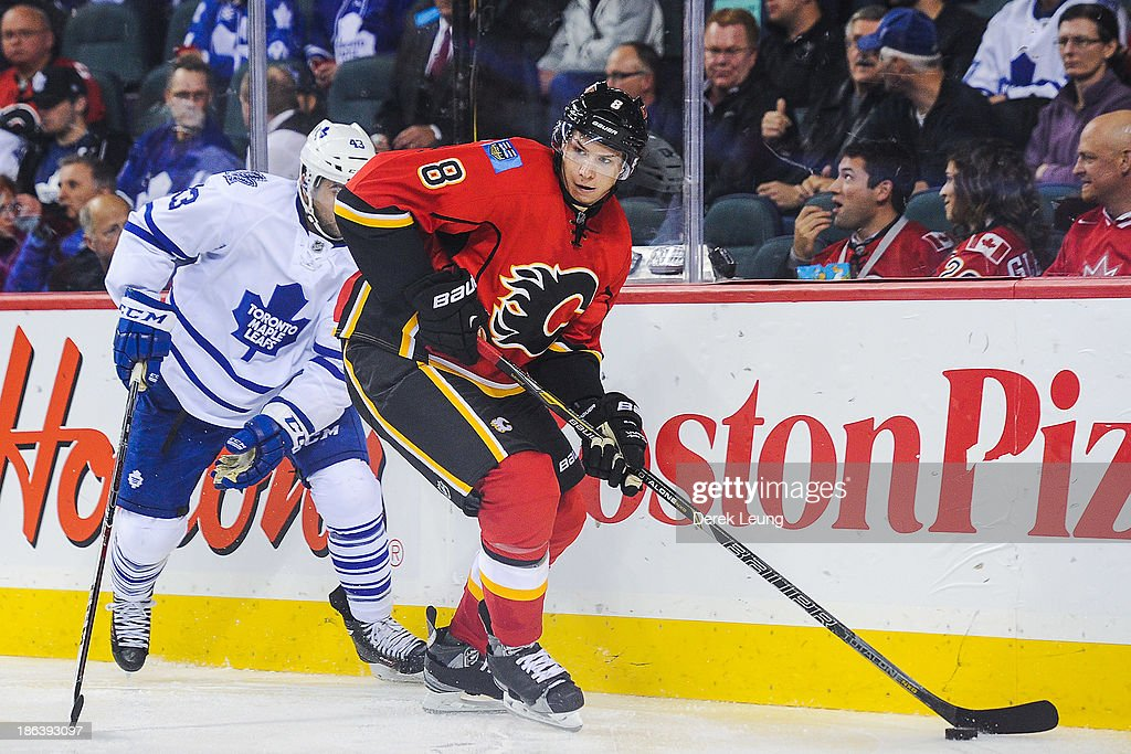 <a gi-track='captionPersonalityLinkClicked' href=/galleries/search?phrase=Joe+Colborne&family=editorial&specificpeople=5370968 ng-click='$event.stopPropagation()'>Joe Colborne</a> #8 of the Calgary Flames skates with the puck past <a gi-track='captionPersonalityLinkClicked' href=/galleries/search?phrase=Nazem+Kadri&family=editorial&specificpeople=4043234 ng-click='$event.stopPropagation()'>Nazem Kadri</a> #43 of the Toronto Maple Leafs during an NHL game at Scotiabank Saddledome on October 30, 2013 in Calgary, Alberta, Canada.