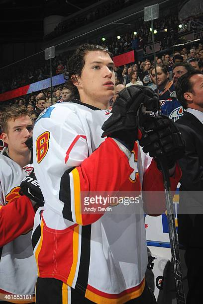 Joe Colborne of the Calgary Flames stands for the singing of the national anthem prior to a game against the Edmonton Oilers on December 7 2013 at...