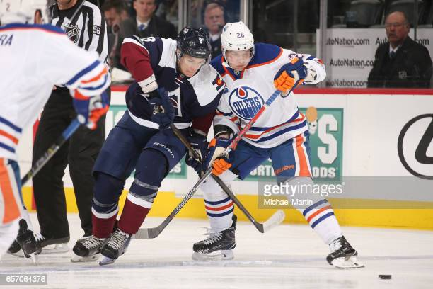 Joe Colborne of the Colorado Avalanche fights for position against Iiro Pakarinen of the Edmonton Oilers at the Pepsi Center on March 23 2017 in...