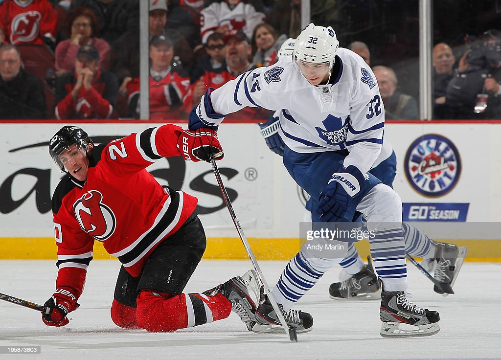 Joe Colborne #32 of the Toronto Maple Leafs collides with Ryan Carter #20 of the New Jersey Devils during the game at the Prudential Center on April 6, 2013 in Newark, New Jersey.