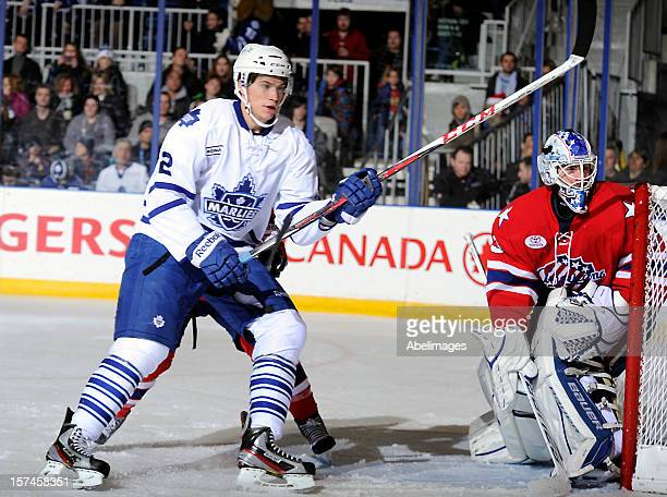 Joe Colborne of the Toronto Marlies looks for a pass in front of David Leggio of the Rochester Americans during AHL game action December 1 2012 at...