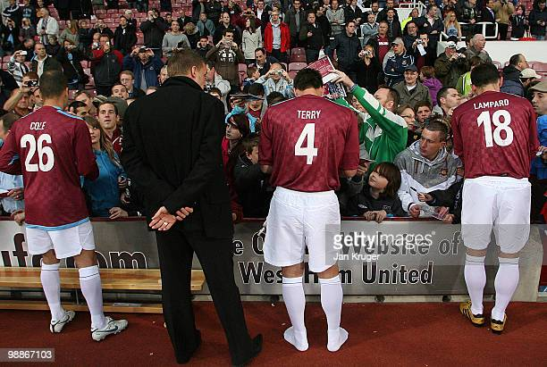 Joe Cole John Terry and Frank Lampard of the Academy AllStars team signs autographs during the Tony Carr Testimonial match between the Academy...