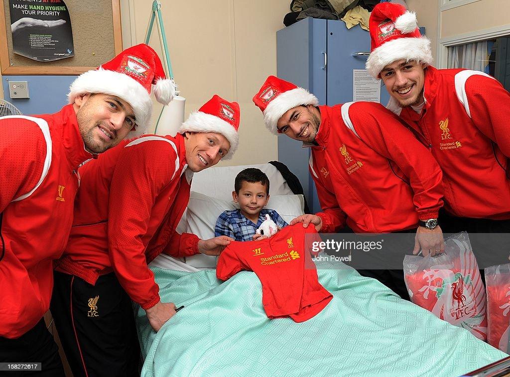 Joe Cole, Lucas Leiva, Luis Suarez and Sebastian Coates of Liverpool FC visit Alder Hey Children's Hospital on December 12, 2012 in Liverpool, England.