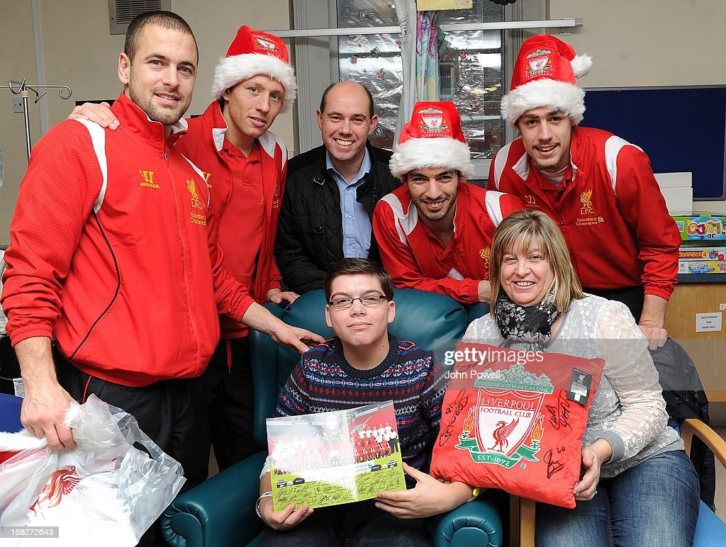 Joe Cole, Lucas Leiva, Luis Suarez, and Sebastian Coates of Liverpool FC visit Alder Hey Children's Hospital on December 12, 2012 in Liverpool, England.