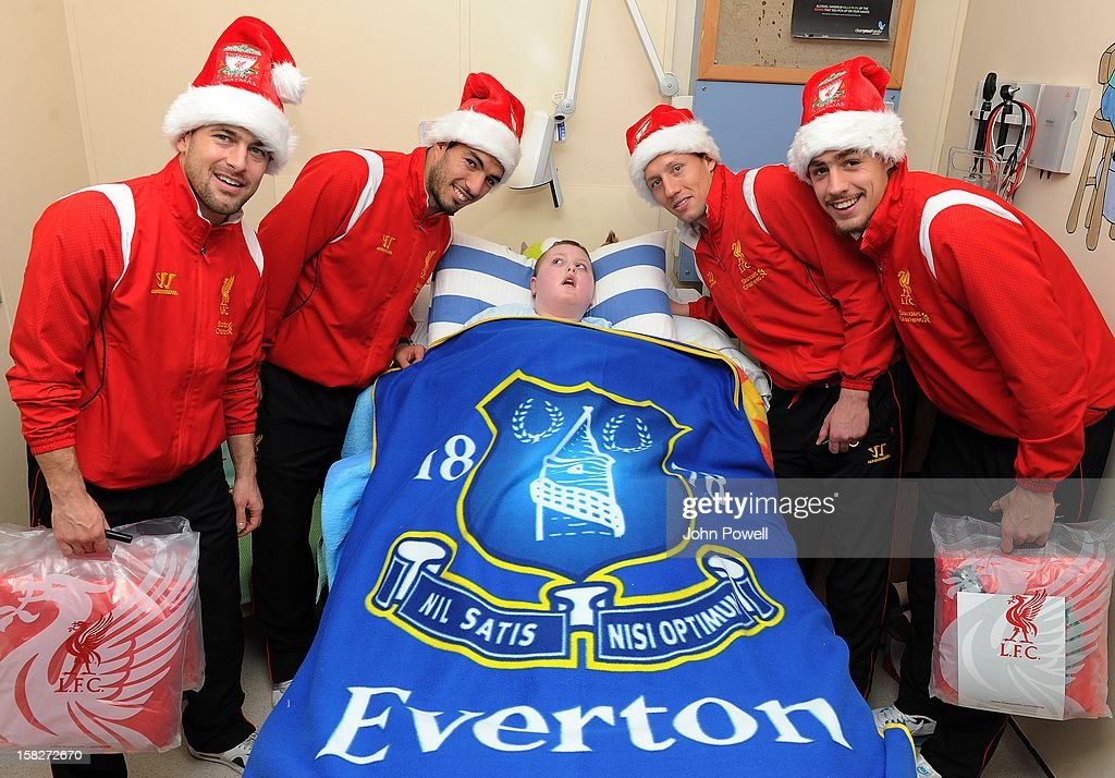 Joe Cole, Luis Suarez, Lucas Leiva and Sebastian Coates of Liverpool FC visit Alder Hey Children's Hospital on December 12, 2012 in Liverpool, England.