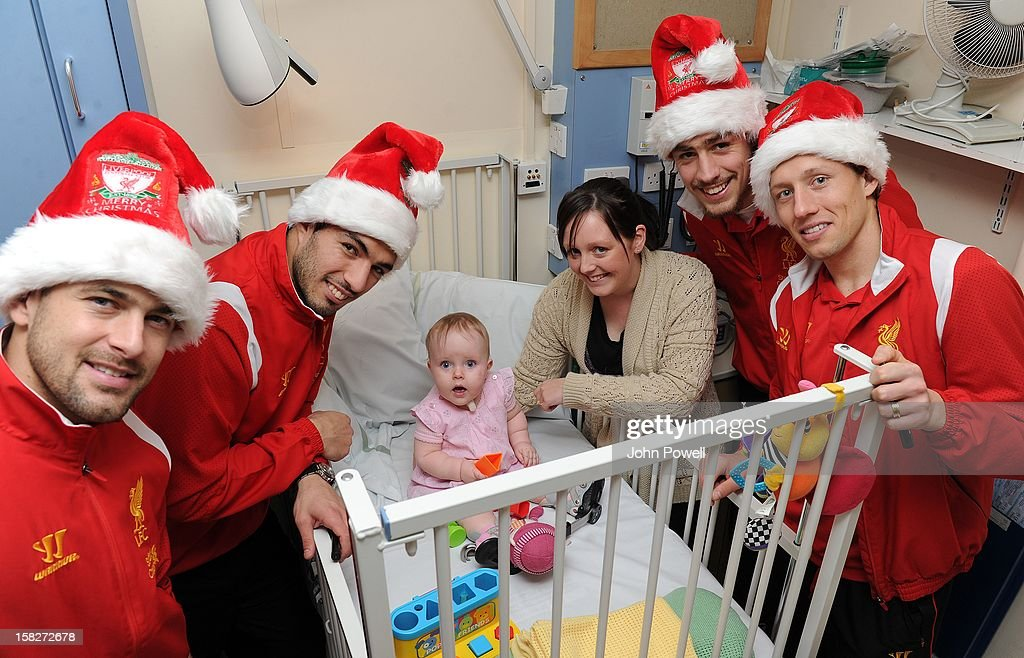 Joe Cole, Luis Suarez, Sebastian Coates and Lucas Leiva of Liverpool FC visit Alder Hey Children's Hospital on December 12, 2012 in Liverpool, England.