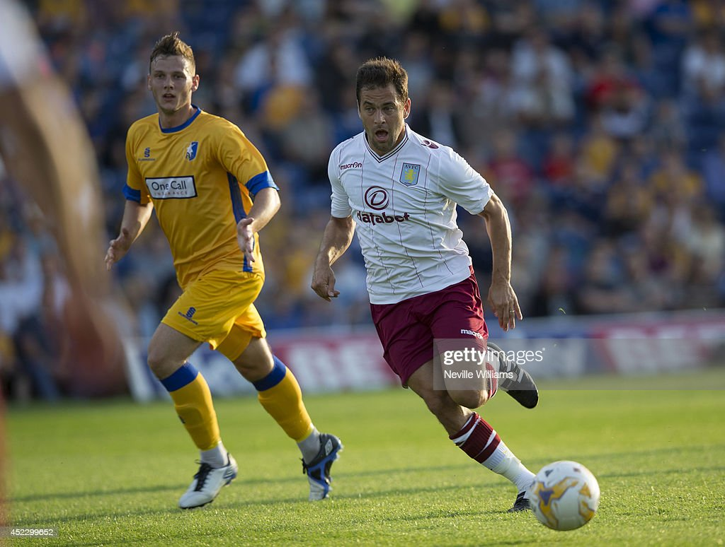 Joe Cole (R) of Aston Villa controls the ball during the pre season friendly match between Mansfield Town and Aston Villa at the One Call Stadium on July 17, 2014 in Mansfield, England.