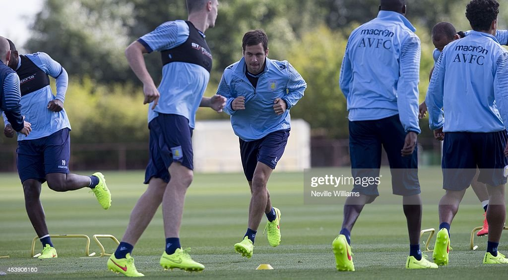 <a gi-track='captionPersonalityLinkClicked' href=/galleries/search?phrase=Joe+Cole&family=editorial&specificpeople=171525 ng-click='$event.stopPropagation()'>Joe Cole</a> of Aston Villa in action during a Aston Villa training session at the club's training ground at Bodymoor Heath on August 21, 2014 in Birmingham, England.