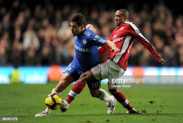 Joe Cole of Chelsea and Gael Clichy of Arsenal battle for the ball during the Barclays Premier League match between Chelsea and Arsenal at Stamford...