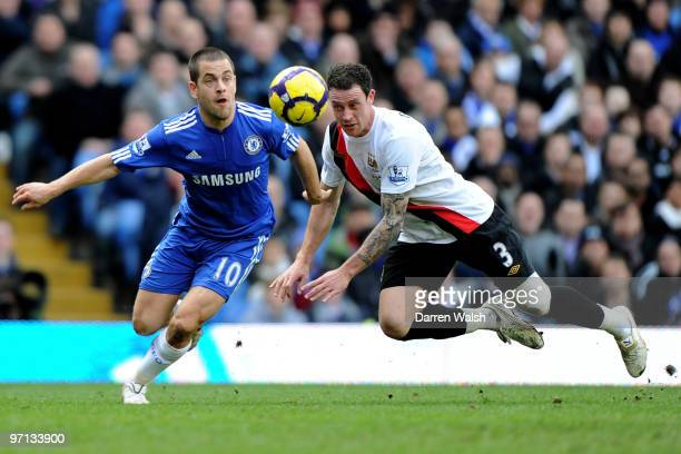 Joe Cole of Chelsea and Wayne Bridge of Manchester City battle for the ball during the Barclays Premier League match between Chelsea and Manchester...