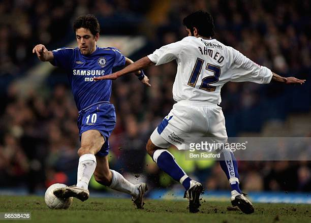 Joe Cole of Chelsea battles for the ball with Adnan Ahmed of Huddersfield Town during the FA Cup third round match between Chelsea and Huddersfield...