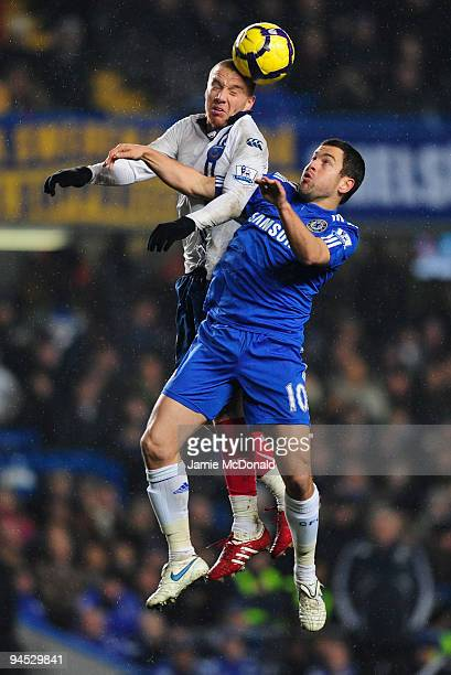 Joe Cole of Chelsea jumps with Jamie O'Hara of Portsmouth during the Barclays Premier League match between Chelsea and Portsmouth at Stamford Bridge...