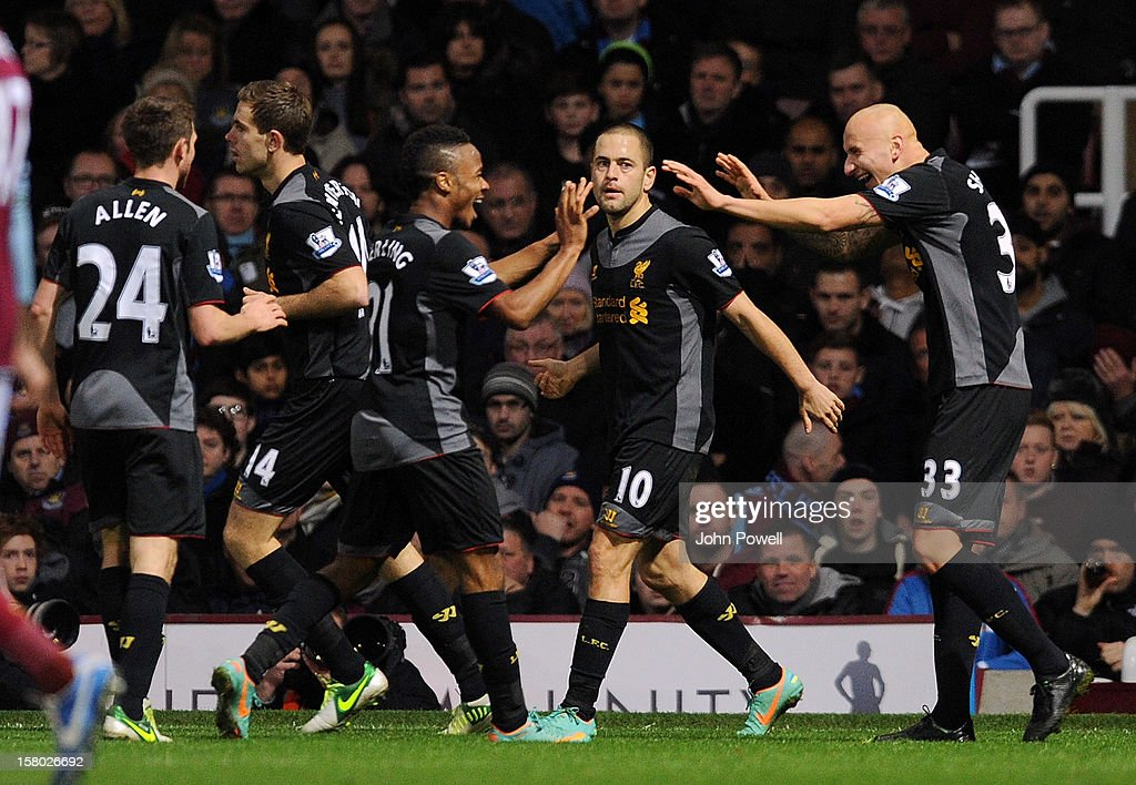 <a gi-track='captionPersonalityLinkClicked' href=/galleries/search?phrase=Joe+Cole&family=editorial&specificpeople=171525 ng-click='$event.stopPropagation()'>Joe Cole</a> (2nd R) of Liverpool celebrates with his team-mates after scoing their second goal during the Barclays Premier League match between West Ham United and Liverpool at Boleyn Ground on December 9, 2012 in London, England.