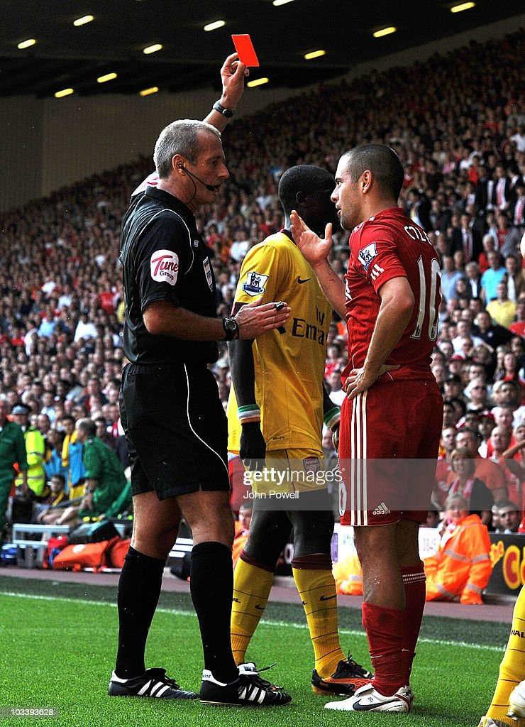 Joe Cole of Liverpool gets a red card during the Barclays Premier League match between Liverpool and Arsenal at Anfield on August 15, 2010 in Liverpool, England.