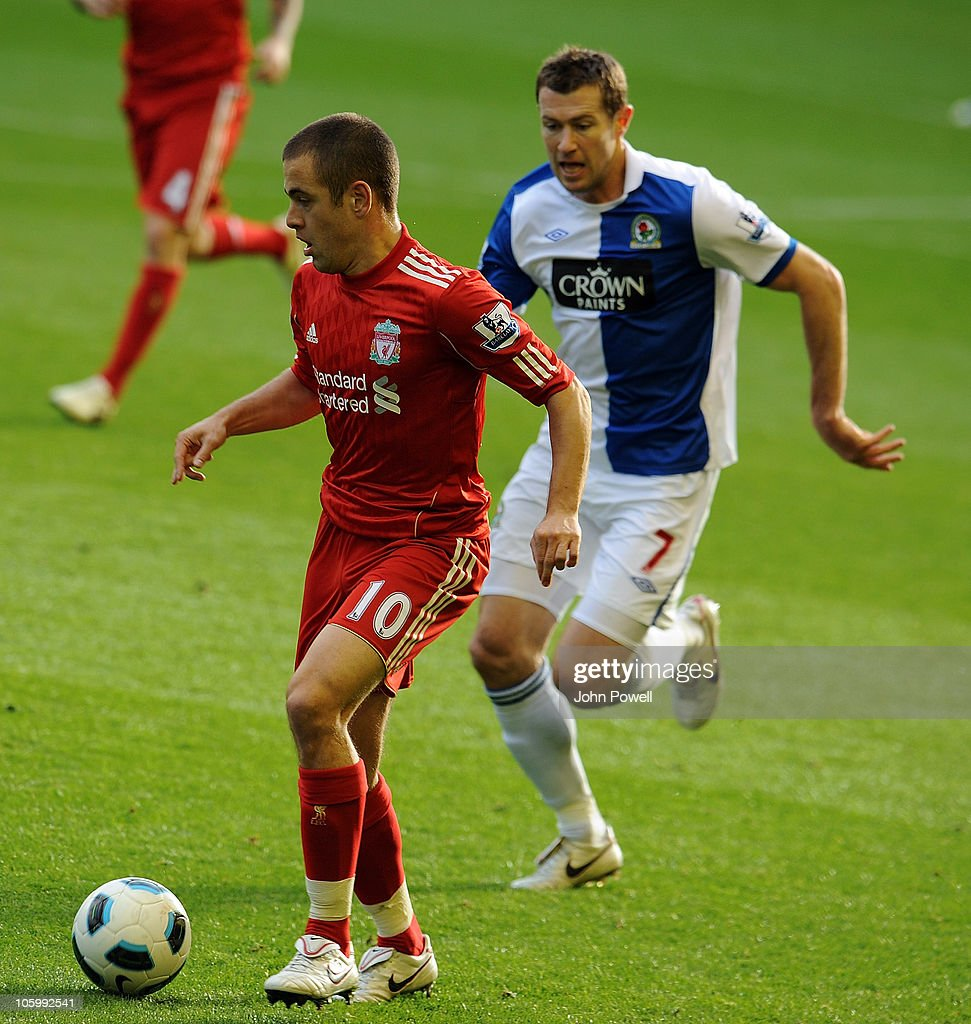 <a gi-track='captionPersonalityLinkClicked' href=/galleries/search?phrase=Joe+Cole&family=editorial&specificpeople=171525 ng-click='$event.stopPropagation()'>Joe Cole</a> of Liverpool is chased by <a gi-track='captionPersonalityLinkClicked' href=/galleries/search?phrase=Brett+Emerton&family=editorial&specificpeople=206493 ng-click='$event.stopPropagation()'>Brett Emerton</a> of Blackburn Rovers during the Barclays premier league match between Liverpool and Blackburn Rovers at Anfield on October 24, 2010 in Liverpool, England.