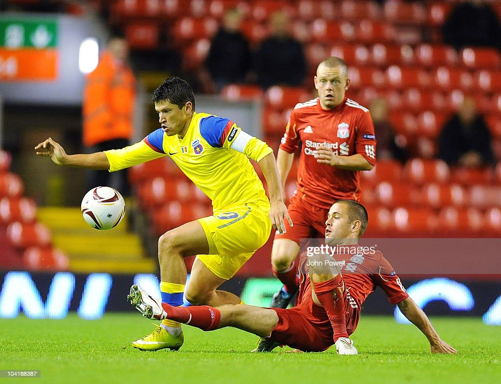 Joe Cole of Liverpool puts in a challenge on Cristian Tanase of Steau Bucharest during the first leg UEFA Europa League match between Liverpool and Steau Bucharest on September 16, 2010 in Liverpool, England.