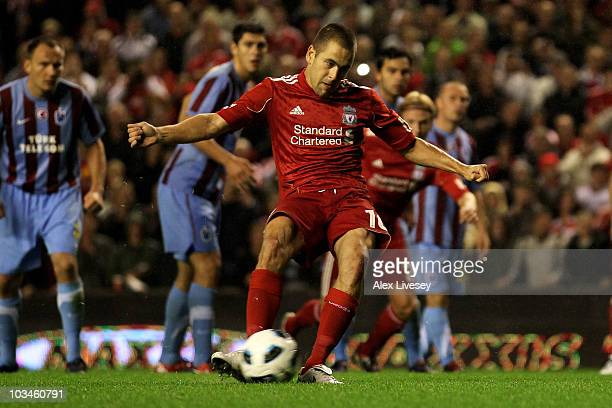 Joe Cole of Liverpool takes and misses a penalty during the UEFA Europa League playoff first leg match beteween Liverpool and Trabzonspor at Anfield...