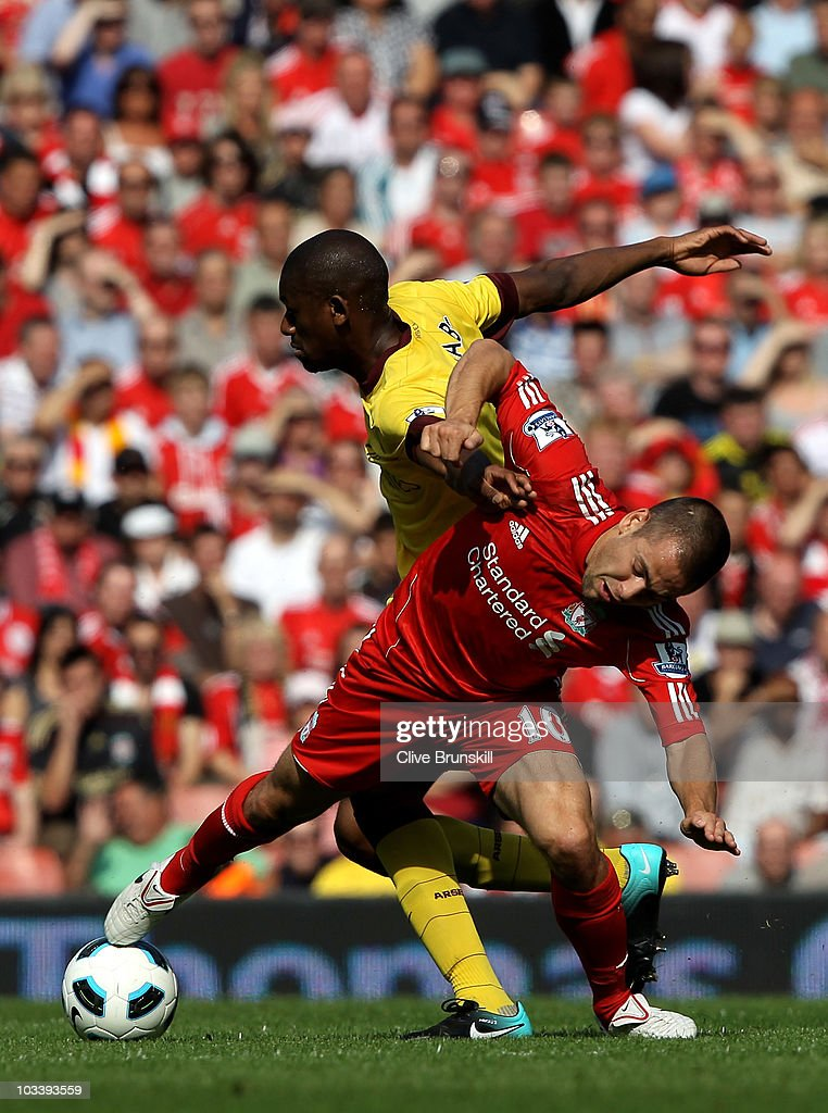 Joe Cole of Liverpool tangles with Abou Diaby of Arsenal during the Barclays Premier League match between Liverpool and Arsenal at Anfield on August 15, 2010 in Liverpool, England.