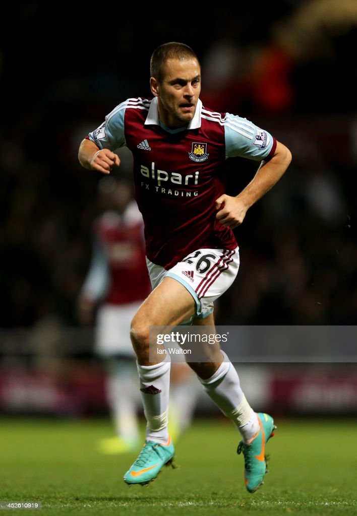<a gi-track='captionPersonalityLinkClicked' href=/galleries/search?phrase=Joe+Cole&family=editorial&specificpeople=171525 ng-click='$event.stopPropagation()'>Joe Cole</a> of West Ham United celebrates as he scores their third goal during the Barclays Premier League match between West Ham United and Fulham at Boleyn Ground on November 30, 2013 in London, England.